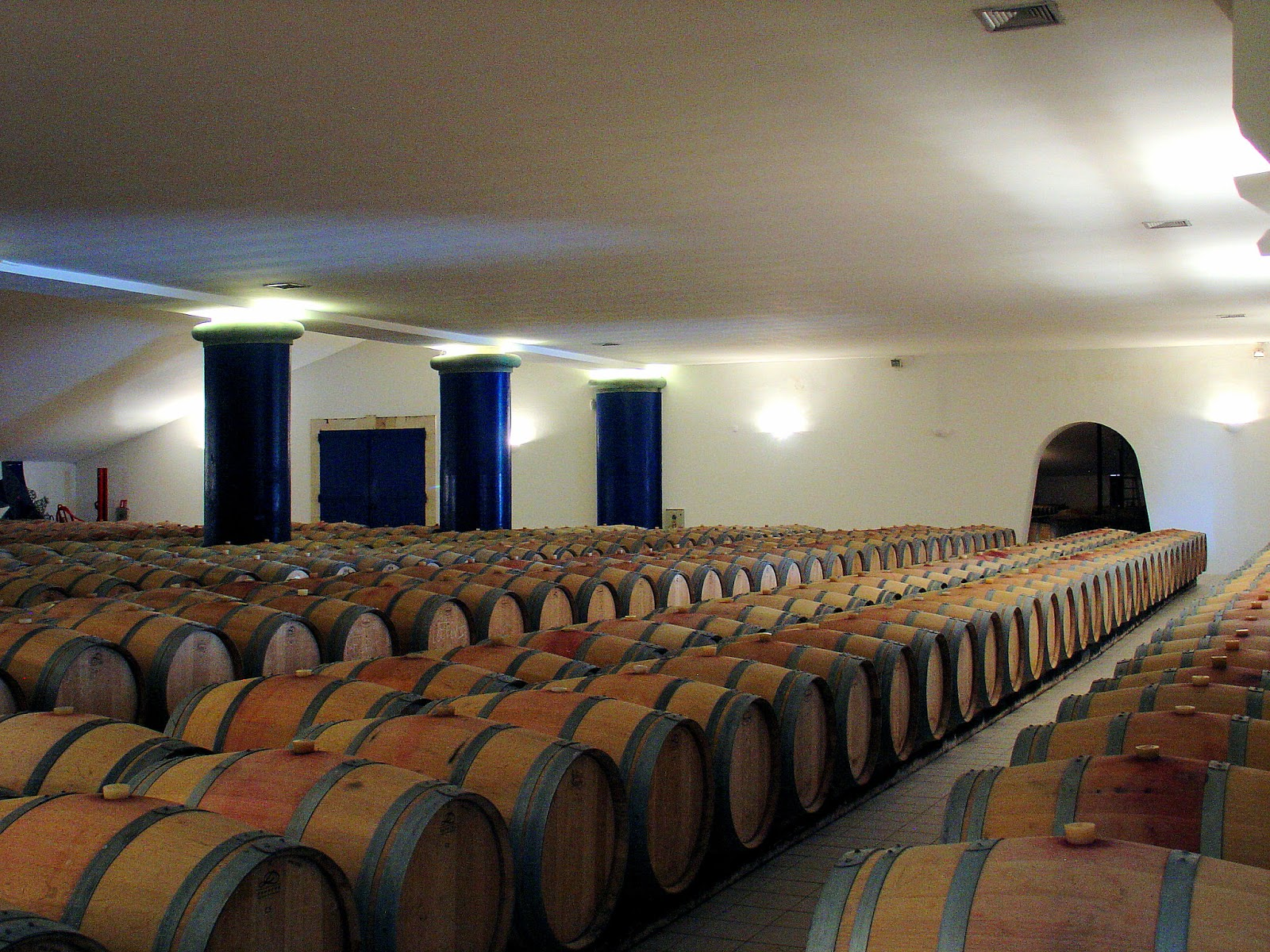 The barrel room where the wine is stored and racked (a process of transferring aging wine from one barrel to the next to eliminate the sediments).
