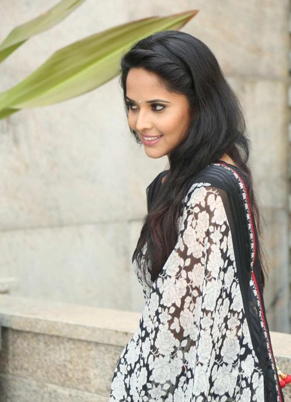 indian tv star anasuya long hair stills in black saree indian tv stars