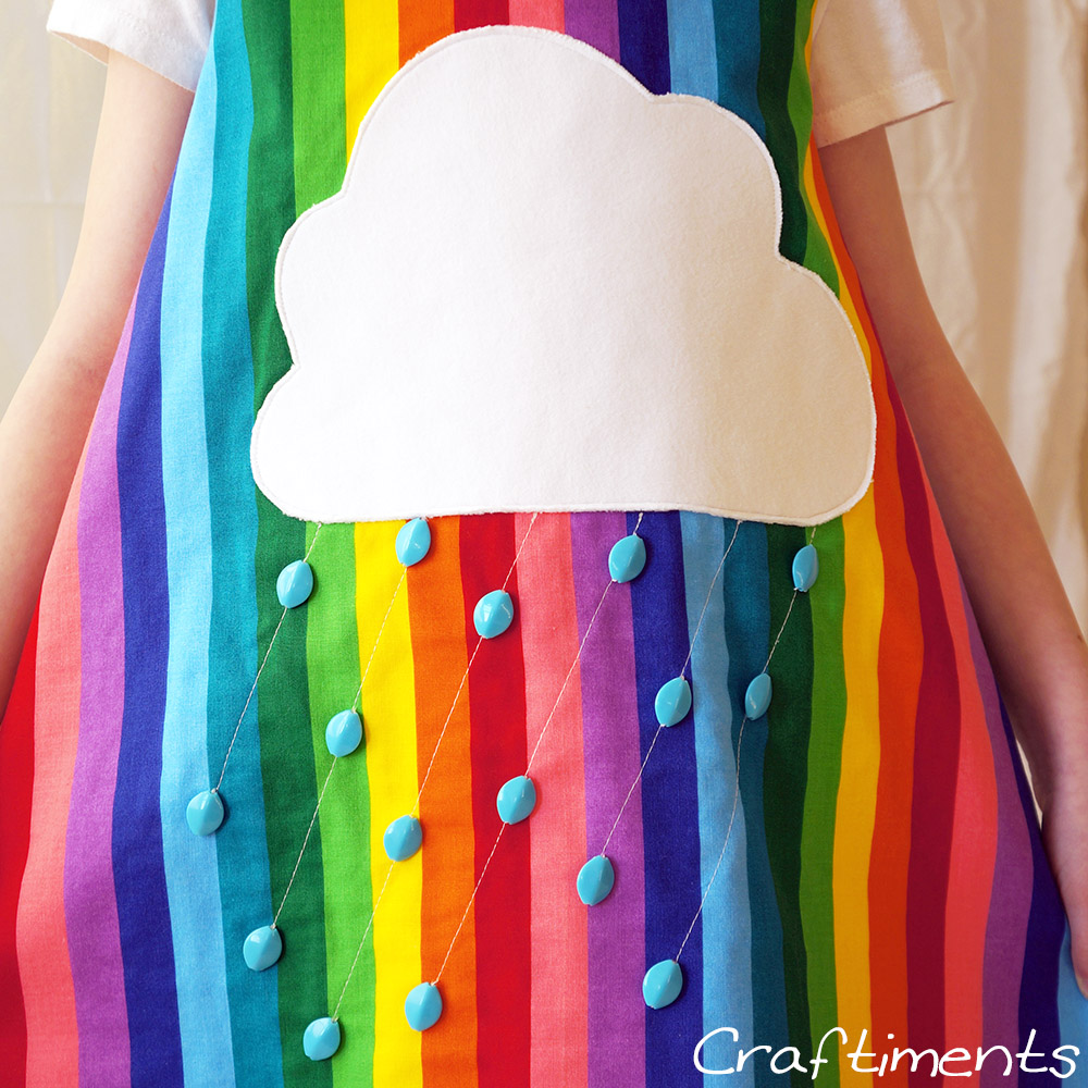 Craftiments:  Closeup of raincloud applique on rainbow striped jumper dress