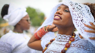 "Women at a festival honoring an African goddess in February 2018MARIO TAMA / GETTY Share Tweet Email ""We may not be Christian here, but we still pray,"" said a woman dressed entirely in white as she addressed a large audience of African American women. Standing behind a lectern, speaking in the cadences of a preacher, she added, ""I understand God more now, doing what I'm doing, than I ever did in the Church.""  The call and response that followed (""No one's going to protect us but who?"" ""Us!"") was reminiscent of church—but this was no traditional sermon. The speaker, Iyawo Orisa Omitola, was giving the keynote address last month at the third annual Black Witch Convention, which brought together some 200 women in a Baltimore reception hall. The small but growing community points to the hundreds of young black women who are leaving Christianity in favor of their ancestors' African spiritual traditions, and finding a sense of power in the process.  Sign up for The Atlantic's daily newsletter.  Each weekday evening, get an overview of the day's biggest news, along with fascinating ideas, images, and voices.  Email Address (required) Enter your email Sign Up Thanks for signing up!  Over the past decade, white Millennials have embraced witchcraft in droves. Now a parallel phenomenon is emerging among black Millennials. While their exact numbers are difficult to gauge, it's clear that African American pop culture has started to reflect the trend. In the music industry alone, there's Beyoncé's allusion to an African goddess in Lemonade and at the Grammys; Azealia Banks's declaration that she practices brujería (a Spanish term for witchcraft); and Princess Nokia's hit ""Brujas,"" in which she tells white witches, ""Everything you got, you got from us."""