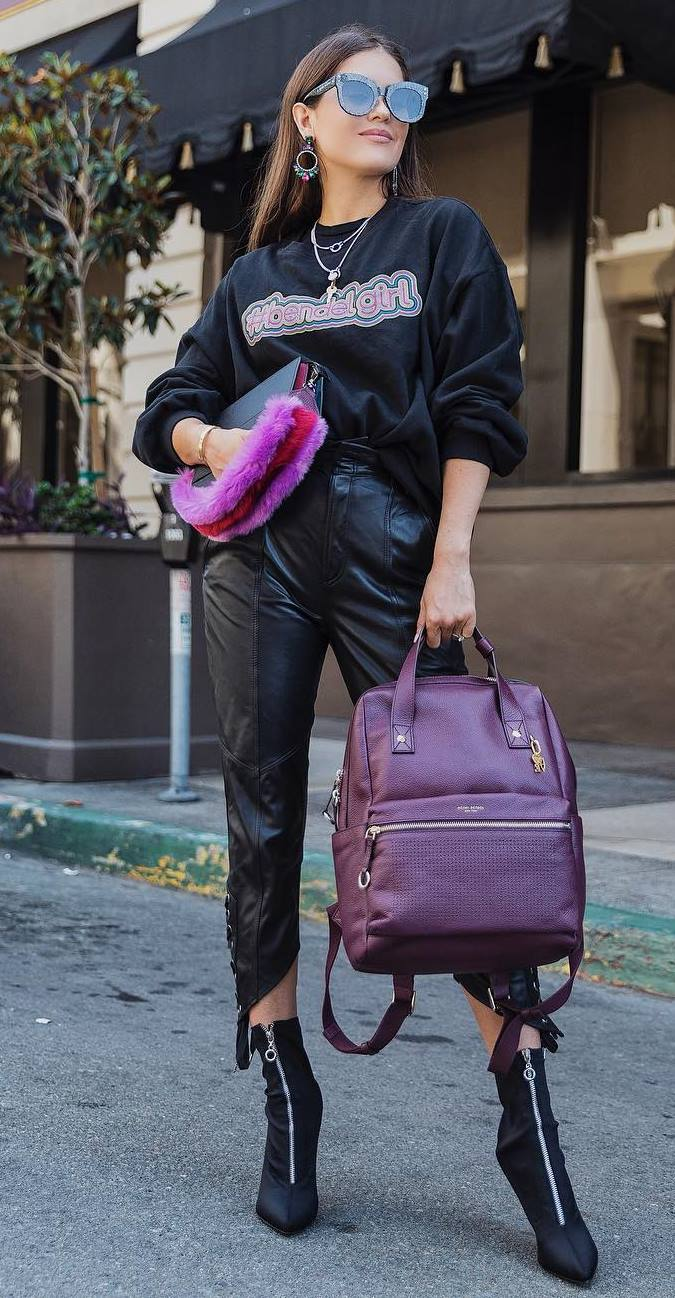 how to style a pair of leather pants : black sweatshirt + burgundy bag + boots