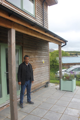 Glen Peters standing outside one of the  two-bedroomed semi-detached houses.