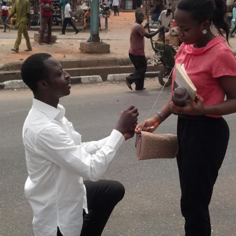 Egbeda market in Lagos love proposes to his girlfriend by a man
