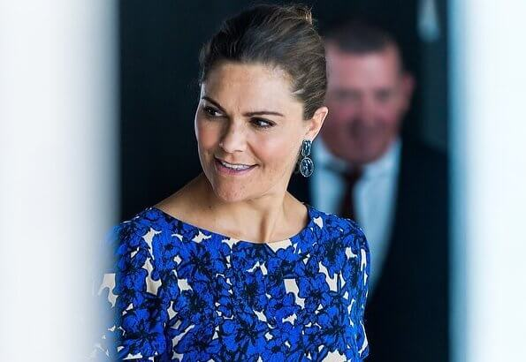 Crown Princess Victoria wore a floral dress by Rodebjer, and navy sandals by Saint Laurent, and blue diamond duchess earrings by Ebba Brahe