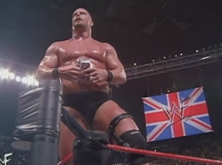 WWE / WWF - WWF Champion Stone Cold Steve Austin celebrates his win over Undertaker and Triple H