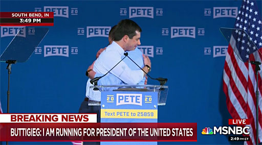 Buttigieg hugs his husband, Chasten, after his speech in South Bend