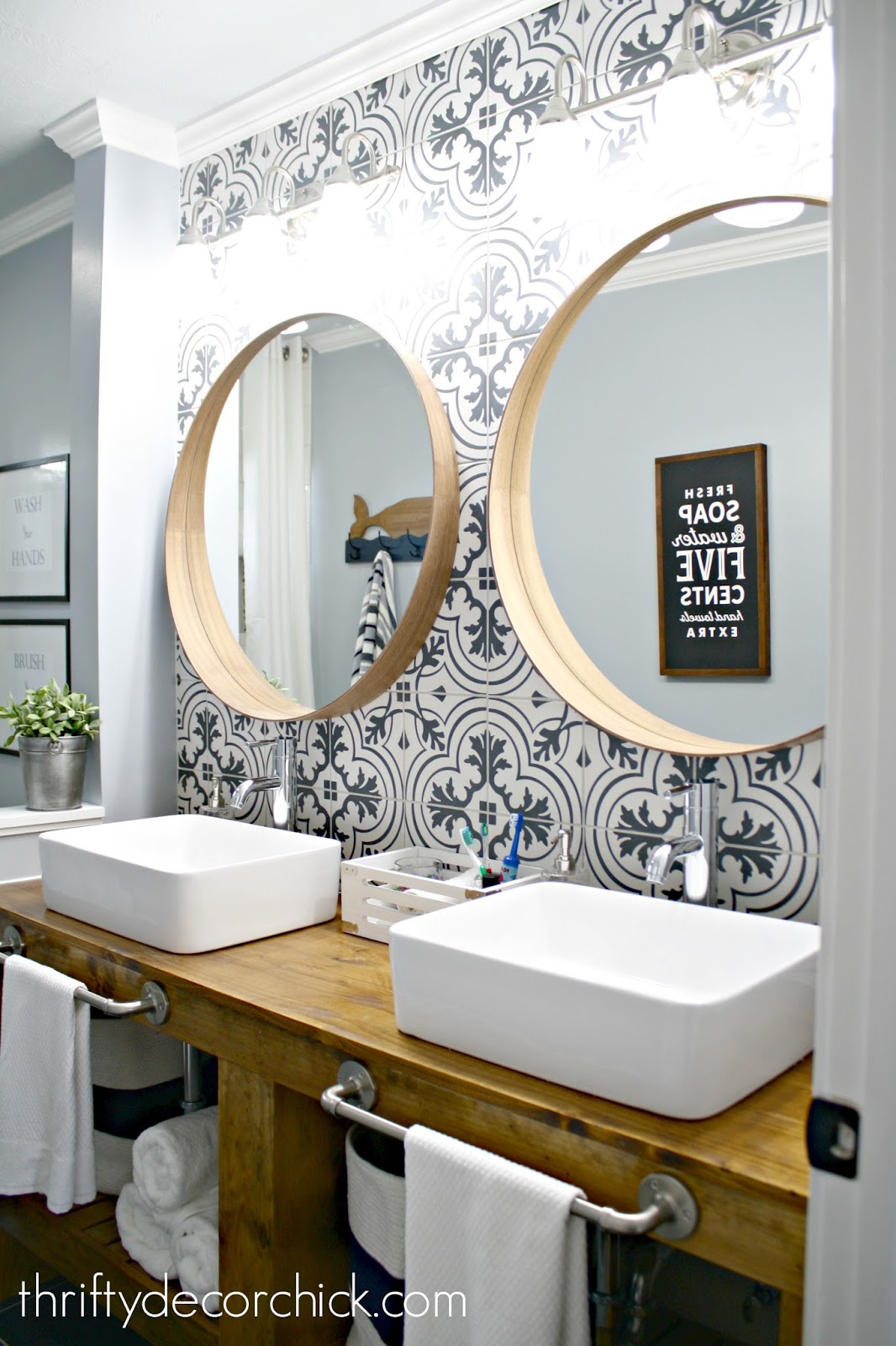 Bathroom makeover with wood vanity, vessel sinks and tile wall