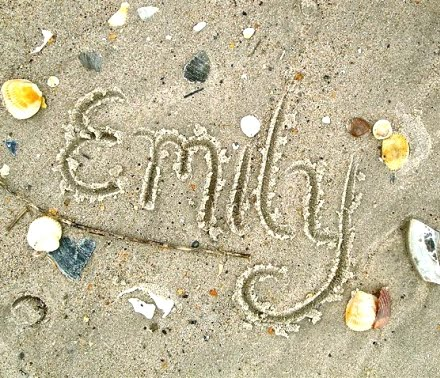 sand writing on the beach