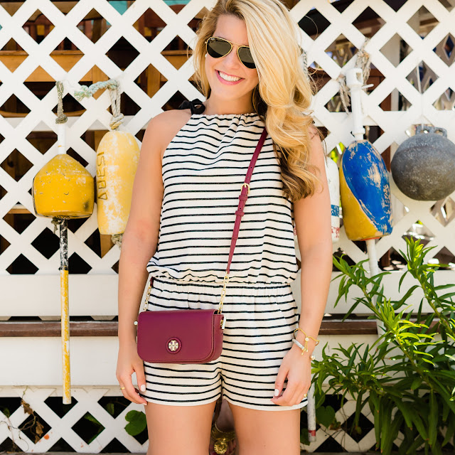 bow tie shoulder romper with tory burch bag at seafood shanty