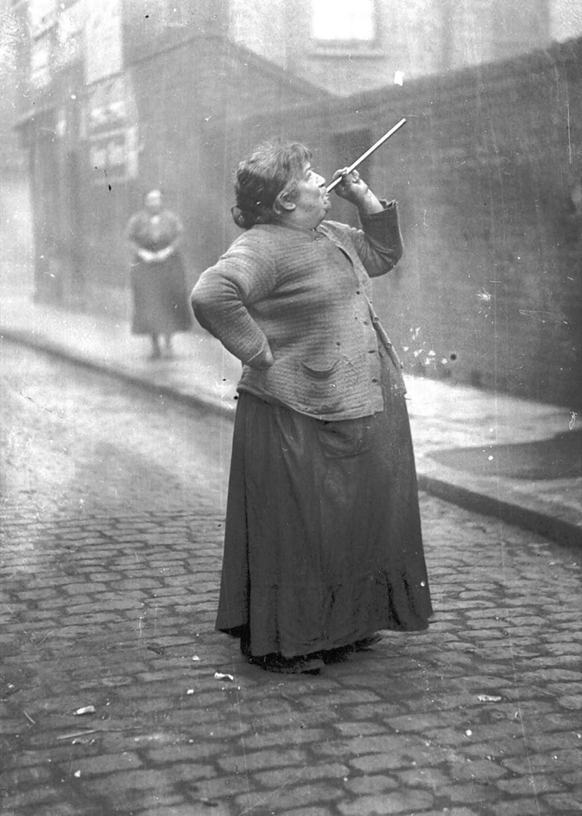 Mary Smith earned six pence a week shooting dried peas at sleeping workers' windows in East London in the 1930s.