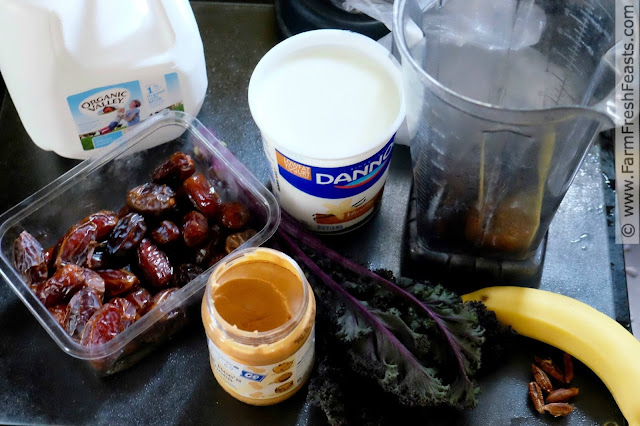 the ingredients for a banana, peanut butter and date smoothie with curly kale