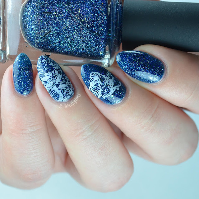 blue jelly holographic nail polish with fish stamping