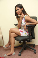 Nishi Ganda stunning cute in Flower Print short dress at Tick Tack Movie Press Meet March 2017 109.JPG
