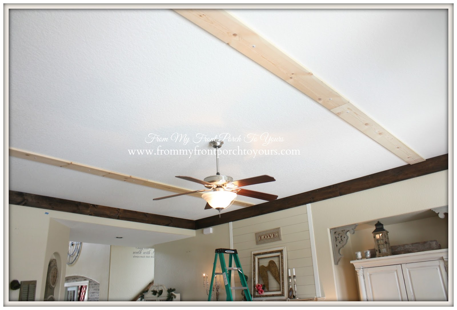 Easy install of 1x8 pine boards for living room wood beams at From My Front Porch To Yours.