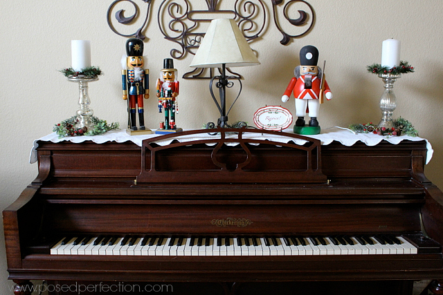 Nutcracker collection on top of piano.