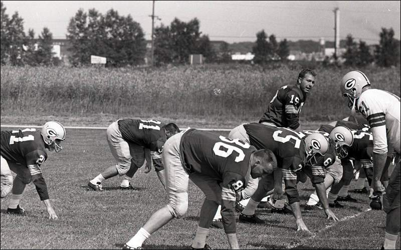 Green Bay Packers quarterback Bart Starr (15) calls signals as training  camp begins on the practice field across from new City Stadium in mid-July  1962. d772426b3