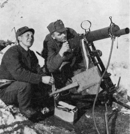 A Norwegian Army machine gun crew with Colt M/29 heavy machine gun, near Narvik, Norway, in May, 1940.
