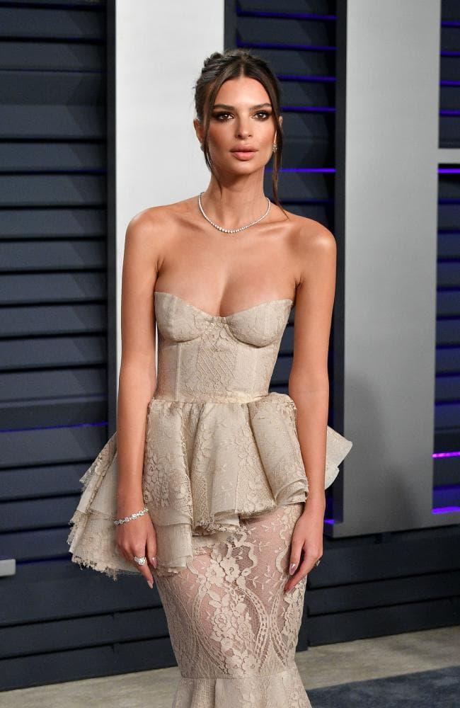 Emily Ratajkowski spills curves in nude corset gown