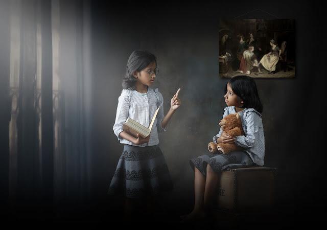 kids playing as teacher