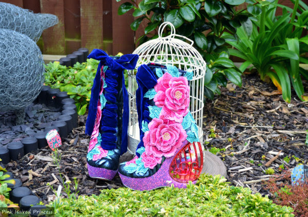 Irregular Choice Maya birdcage boots outdoors with birdcage in background