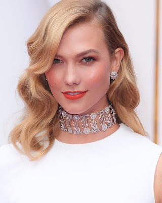 Karlie Kloss Showing her eleganct necklace from her Jewelry Display Collection.