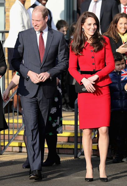 Kate Middleton wore Luisa Spagnoli red suit, Gianvito Rossi black suede pumps, Mulberry suede clutch, Mappin & Webb earrings. Place2Be