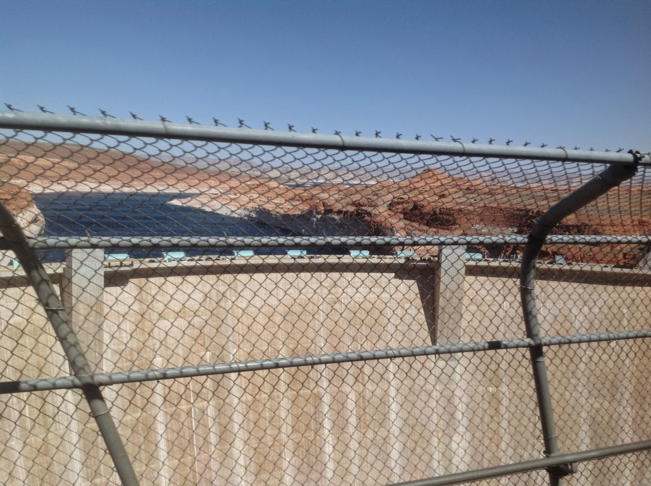 Picture of Glen Canyon Dam taken from adjacent bridge