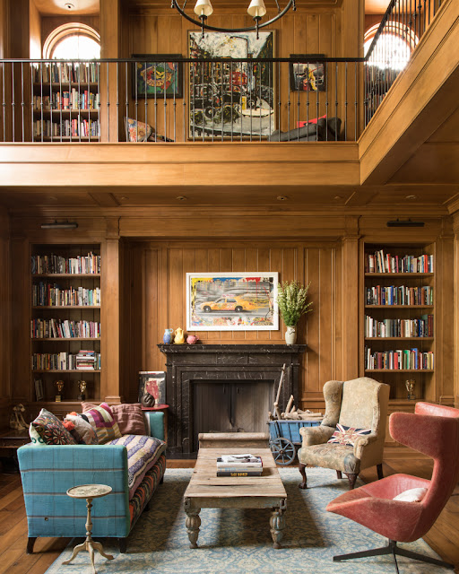 Walnut panelling in library with fireplace and eclectic decor by Samantha O'Connor