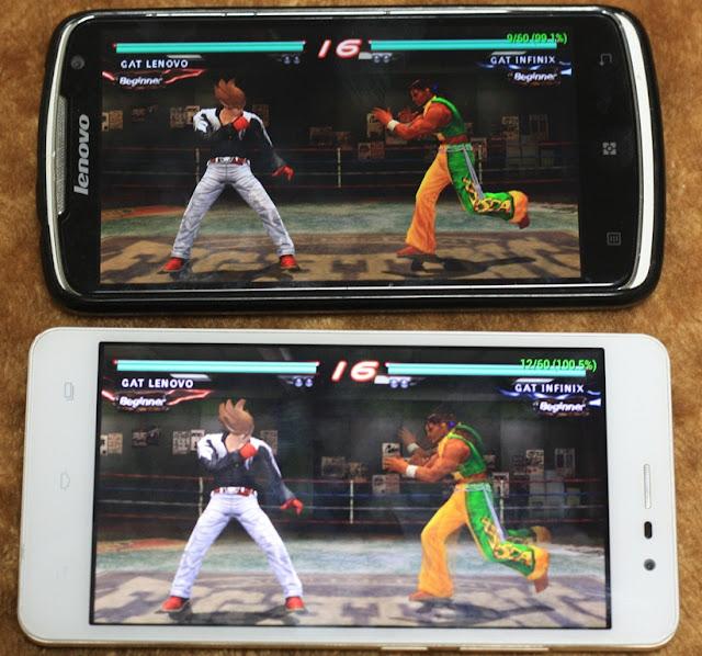 Pada foto ini kita bisa melihat dua buah smartphone android yang terkoneksi dalam game Tekken 6