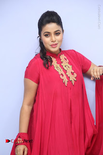 Actress Poorna Latest Stills in Red Dress at Rakshasi First Look Launch  0088.JPG