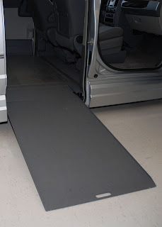 photo of a wheelchair ramp leading into a van
