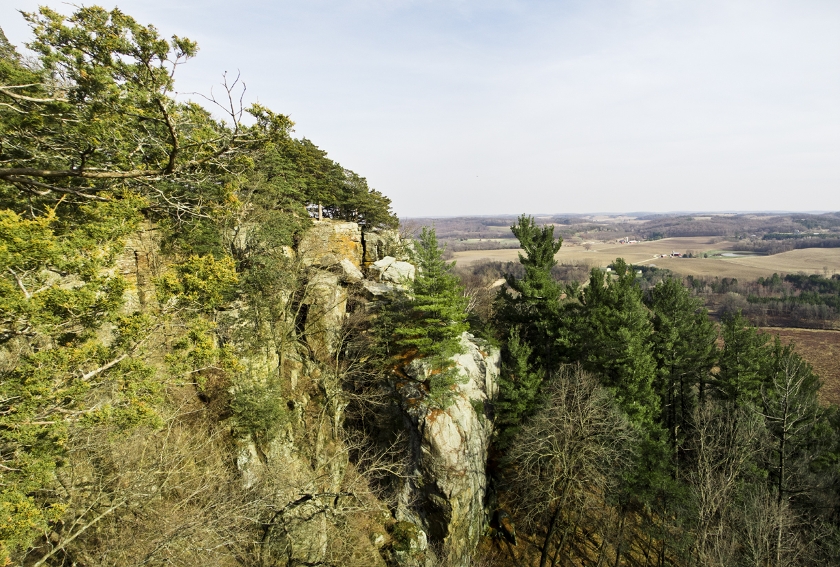 cliff side showing rolling hills beyond
