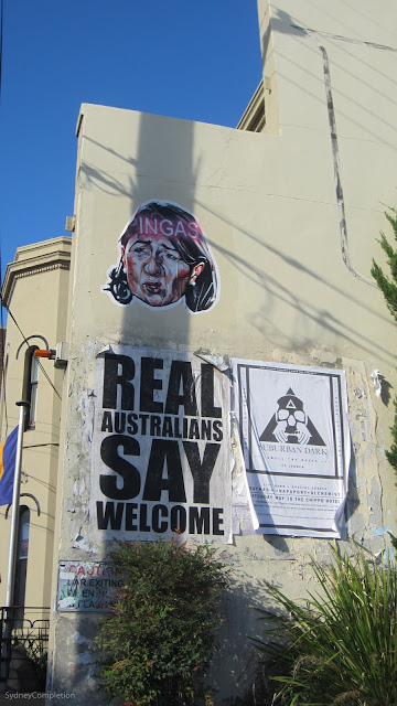 "Street poster of Gladys Berejyklian with ""Pingas"" written over it."