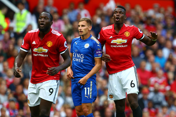 Lukaku and Pogba keeps an eye on the ball and Leicester city midfielder Albrighton during a premier league match