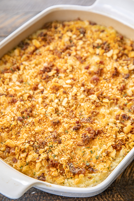 Pepper Jack Potato Casserole - our favorite potato casserole recipe. It is like a cross between traditional potato casserole and scalloped potatoes. LOVE the cheesy bacon cracker crust!!! Frozen shredded hash browns, cream of chicken soup, heavy cream, pepper jack cheese, butter, sour cream, onion powder, garlic powder, ritz crackers, parmesan and bacon. Can make ahead and freeze for later. I always have a batch on hand for a quick and delicious side dish! #potatocasserole #freezermeal #sidedish