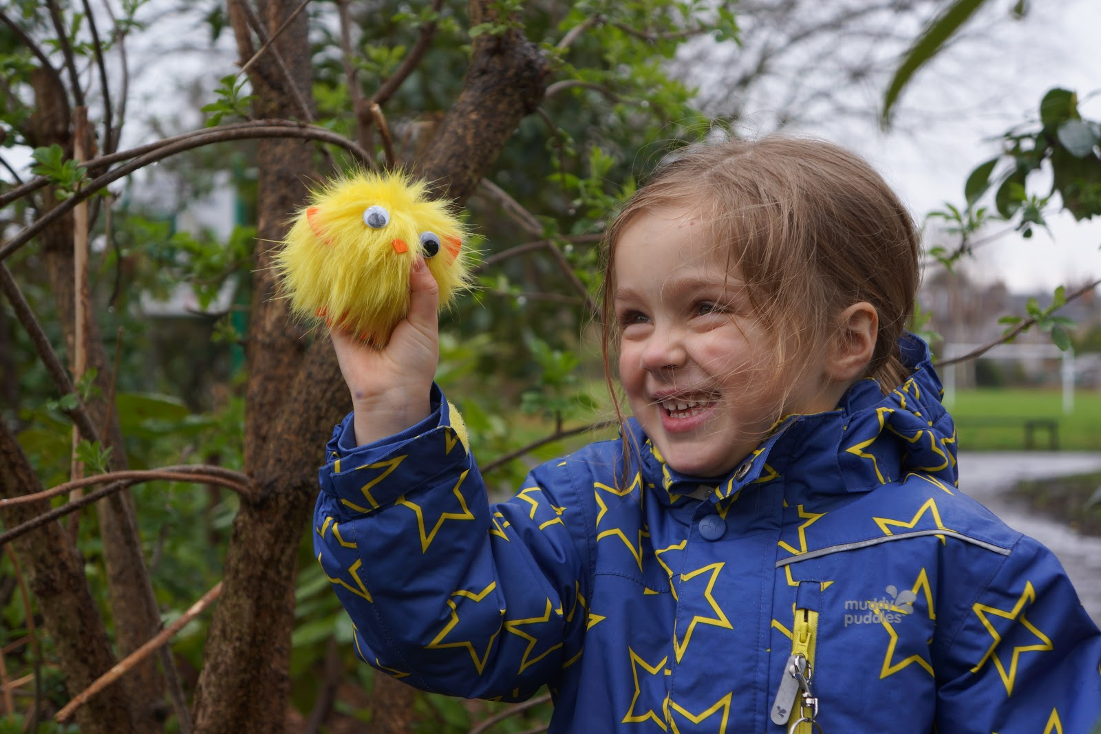 little girls holding a fluffy easter chick toy