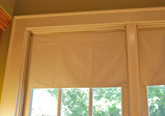 Tip for using lightweight fabric to create a faux Roman shade, staple blackout fabric directly to window behind the shade.