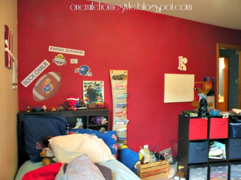 Boy's bedroom with red accent wall - before