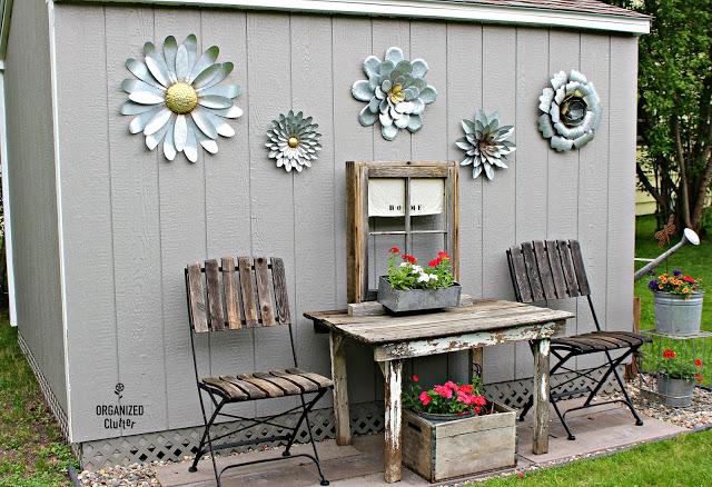 Decorating a Home Depot Shed Kit with JUNK #junkgarden #gardenjunk #flowergarden #containergarden  #stencils