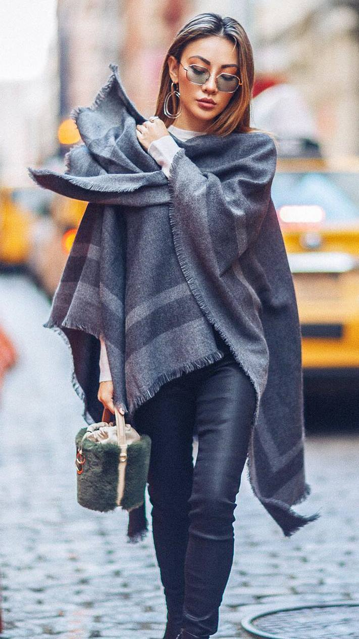 what to wear with a poncho : leather pants + fur bag + sweater