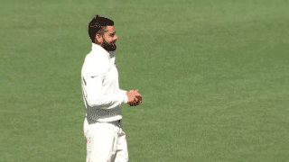 Virat Kohli bowls during India tour game at the SCG