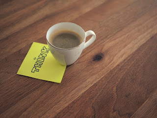 Coffee cup and sticky note