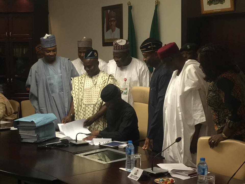 Acting President, Prof. Yemi Osinbajo Signs The 2017 Budget Bill Into Law - Photos