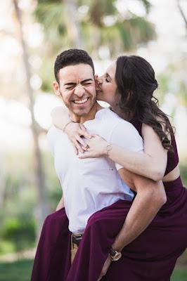 engaged kisses