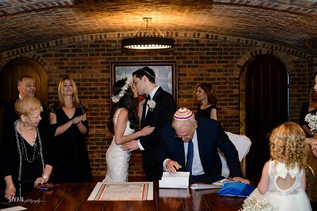 jewish wedding at bella collina-bride and groom kissing