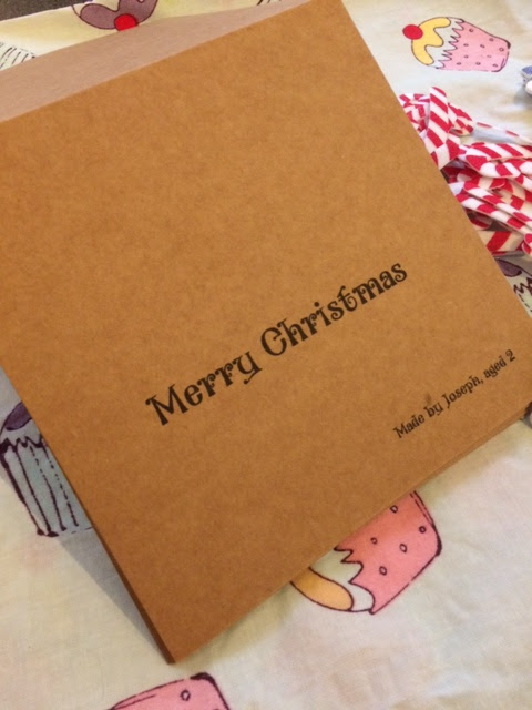 Little brown card with Merry Christmas printed upon it