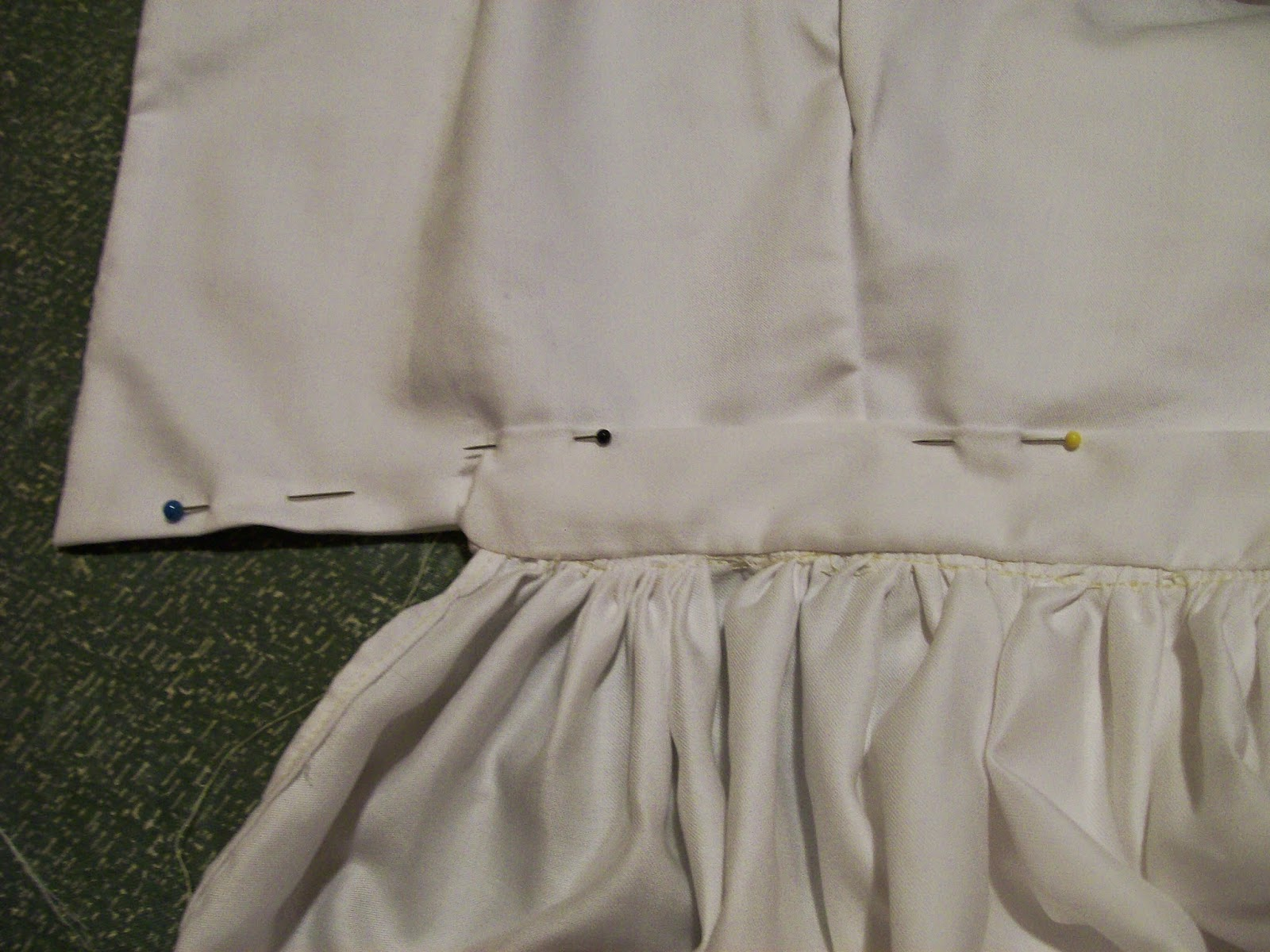 Finishing the bodice placket.