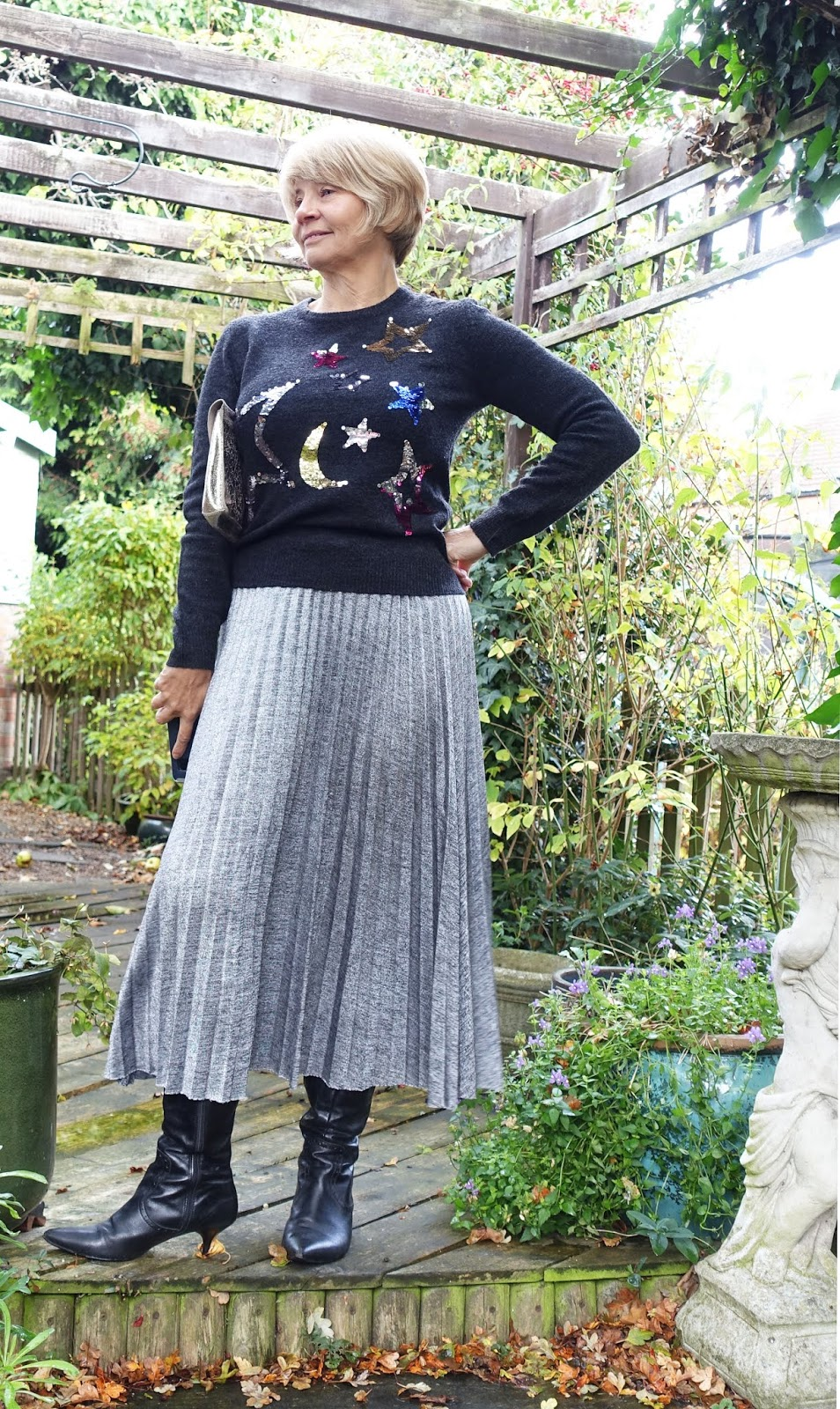 Over-45s style blogger Is This Mutton? in sequinned stars jumper and silver pleated skirt