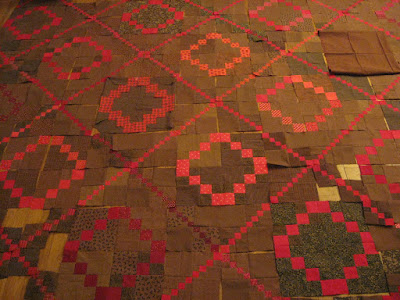 Red and brown double and triple four-patch quilt blocks