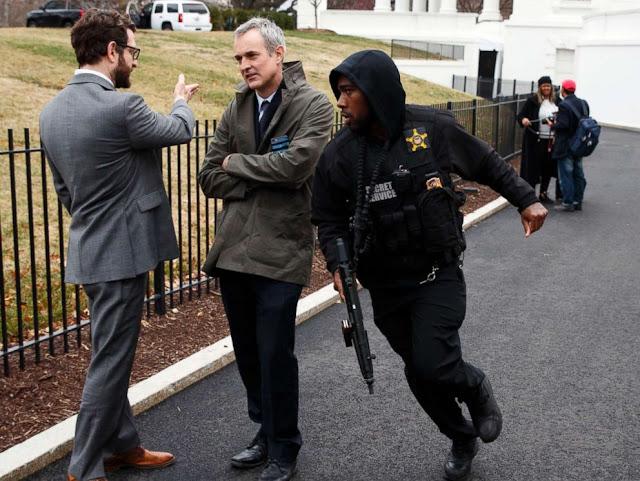 Van strikes security barrier near White House, armed driver apprehended